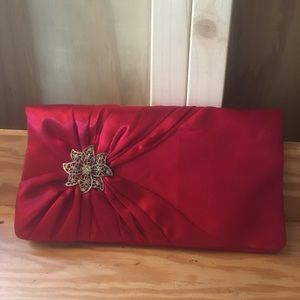 Red Clutch Purse With Flower Embellishment